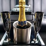 Bottle of champagne in the car