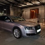 Silver Audi car hire outside hotel