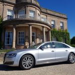 Silver Audi hire car hire outside a castle