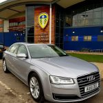 Silver Audi car hire outside Leeds United Academy