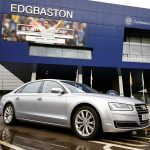 Silver Audi hire car outside stadium