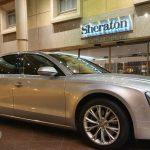 Silver car hire outside Sheraton Hotel