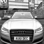 Black and white image of Audi car outside Blackburn Rovers