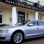 Silver Audi car outside Crown Spa Hotel